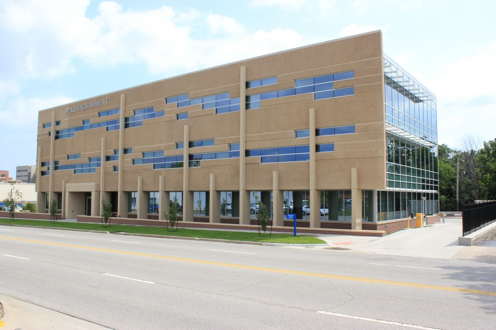 The KU Endowment Building was completed in 2010 .  The architect used the design flexibility of precast to create the bold window shapes.  The upper wall panels on this building have an exposed aggregate finish using limestone and river gravel aggregate.  The lower panels have inlaid brick and the columns use a sandblast finish.